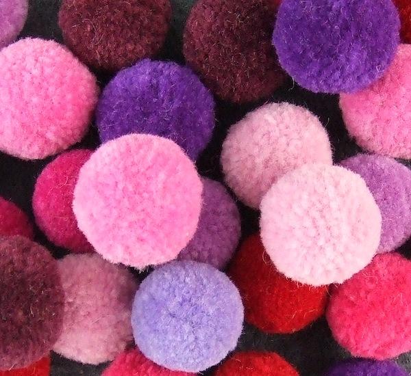wool pom poms purples pinks. Black Bedroom Furniture Sets. Home Design Ideas